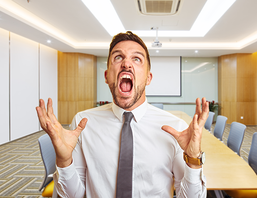 frustrated_guy_in_conference_room_519x400